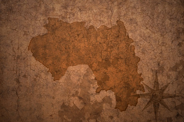 guinea map on a old vintage crack paper background