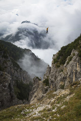 Man walking on highline in Dolomites