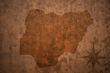 nigeria map on a old vintage crack paper background