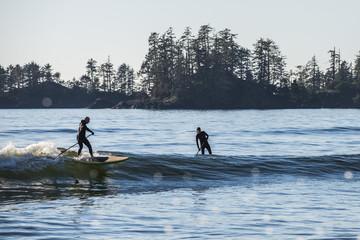 Paddle board surfing in Tofino, British Columbia.