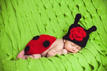 Cute Baby In Ladybug Dress Sleeping