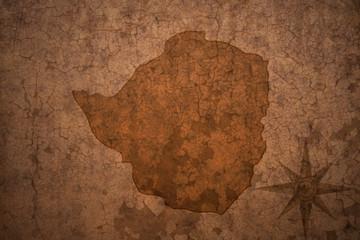 zimbabwe map on a old vintage crack paper background