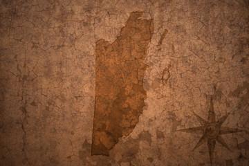 belize map on a old vintage crack paper background