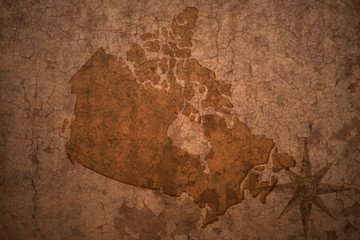 canada map on a old vintage crack paper background