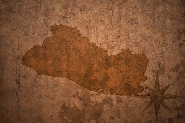 el salvador map on a old vintage crack paper background