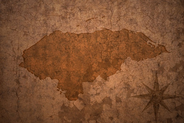 honduras map on a old vintage crack paper background