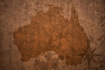 australia map on a old vintage crack paper background