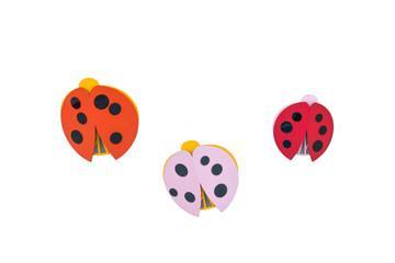 Ladybugs made from wood isolated on white background