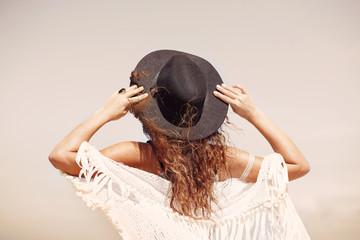 bohemian girl in hat outdoors