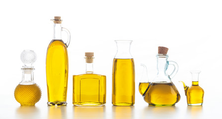 Set of bottles with olive oil on white background