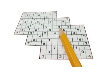 Closeup of Sudoku with a pencil