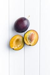 Halved ripe plums.