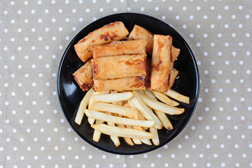 Chinese Vegetable festival  food as deep fried spring roll and French fries served.