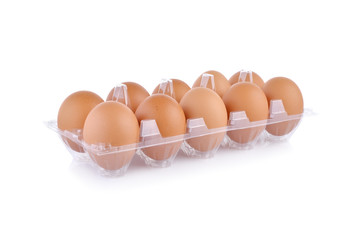 eggs in transparent tray package on white background