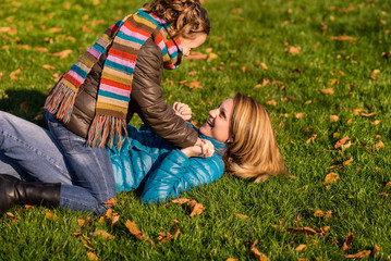 Mother and daughter have a walk in the autumn park