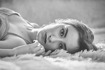 pensive girl lying