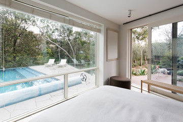 Large windows showing view to pool and garden in luxury home