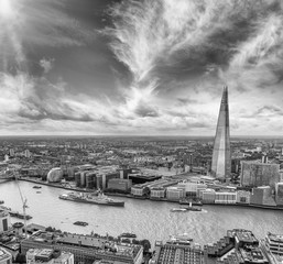 Black and white aerial view of London skyline over Thames river,