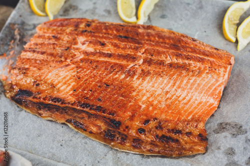 Salmon red fish fillet grilled at barbecue imagens e for Red fish fillet