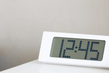 White clock digital on white table