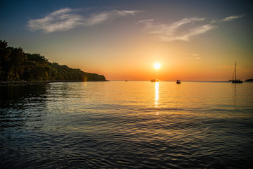 Rovinj, CROATIA - JUNE 11, 2016: A view of coast Roinj, Adriatic Sea at sunset time in Rovinj, Croatia on June 11, 2016.