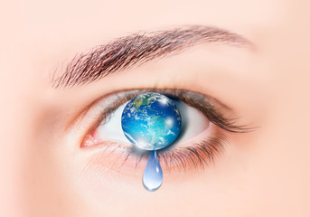 "Planet earth in eye isolated - ""Elements of this image furnished by NASA"""