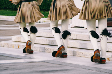 Closeup of the uniforms of the Evzones (Greek Presidential Guards) in front of the Hellenic Parliament in Athens.