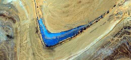 boomerang blue in the desert.composition,abstract landscapes ,Abstract Naturalism,abstract photography deserts of Africa from the air,abstract surrealism, ,fantasy forms of stone in the desert