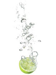lime dropped in water isolated on white