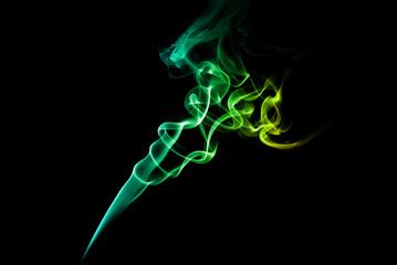 Green and blue smoke on dark
