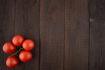 Tomatoes on old wooden table.