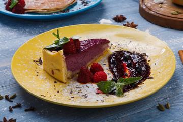 Restaurant dessert. Berry tart on blue wood