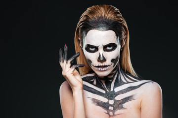 Portrait of young woman with scared halloween makeup