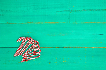 Candy cane border on green wood background