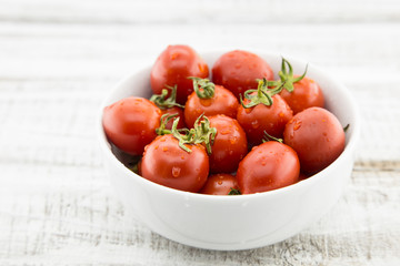 Fresh cherry tomatoes in white ceramic bowl