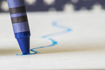 Blue crayon close up