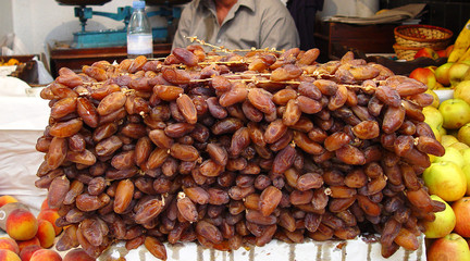 Tunisian dates laid by a wall on a local market