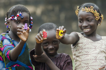 Learning the Alphabet - Beautiful African Portrait of Children Smiling Outdoors