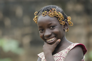 Gorgeous African Girl Thinking about her Future whilst laughing and smiling happily