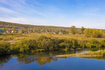 Rural autumn landscape with river