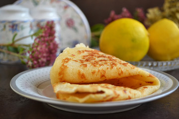 Vanilla crepe. Tasty sweet breakfast. Still life. End brunch on a sweet note with pretty and tasty paper-thin crepes.