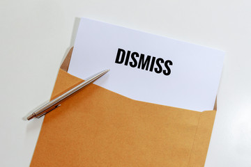 Dismiss document in envelope with pen on table - business concept