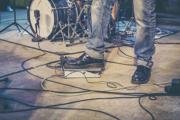 Foot on guitar pedal