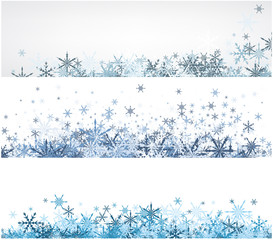 Winter banners set with blue snowflakes.