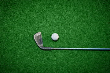 Golf ball and Golf Club on Artificial Grass vignetted