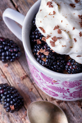 """Cup of fresh natural blackberries with whipped cream"""" Stock photo and ..."""