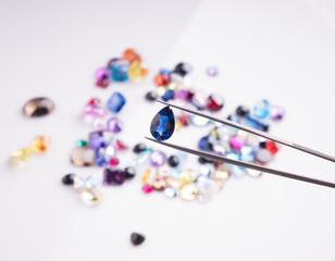 Jewel or gems on White shine color, Collection of many different natural gemstones  amethyst, lapis lazuli, rose quartz, citrine, ruby, amazonite, moonstone, labradorite, chalcedony, blue topaz