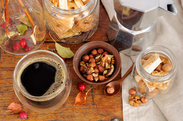 Still life with coffee, nuts and small apples
