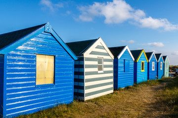 Row of blue beach hut at Southwold beach, UK