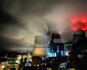 Thermal Power Station And Illuminated City At Night